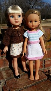 A cap-sleeved dress with striped bodice, paired with a three-quarter sleeve cardigan sweater. Constructed raglan-style from the top down, the bodice and sweater are knit flat, then the dress is joined in the round below the button placket. Change the colors to suit your doll's spring or fall wardrobes! Sized for the Les Cheries and Hearts for Hearts dolls, or other similar sized dolls.