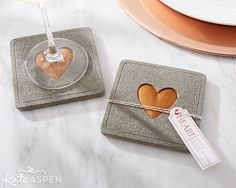 Concrete coaster with a copper heart | Insustrial Wedding Favors from Kate Aspen