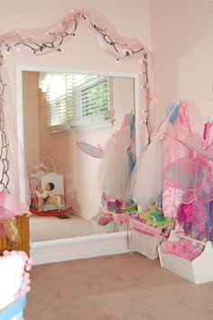 Pretty dress up area, maybe the mirror i have that i said i would give you, then add tule and lights to it, she would love having this in her room as she is so prissy!!