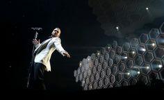 Justin Timberlake striking in a white jacket