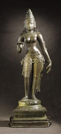 Bhudevi, c. 1025, Tamil Nadu, 26-1/2 x 9-1/2 x 8 in. Vishnu is often depicted with his consorts Sri Lakshmi and Bhu Devi. Sri Lakshmi, the goddess of beauty and good fortune, is Vishnu's main consort. She is distinguished from Bhu Devi by the breast band (kuchabandha) that adorns her chest. Bhu Devi is the earth goddess. Although she is just as beautiful as Sri Lakshmi, she does not have any distinguishing features.