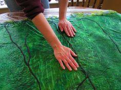 The basics of Nuno felting tutorial.  Nuno Felting is blending 2 fibers- silk and wool.  Members made their own Nuno Felt scarves in today's Art Workshop.