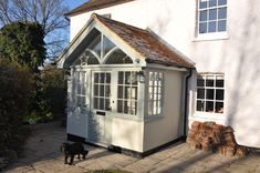 Finally our porch is complete (painted in Pigeon and Bone, Farrow and Ball)