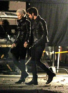 I think they're holding hands!! Awww.-- She didn't go dark she just wanted to dress like her boyfriend