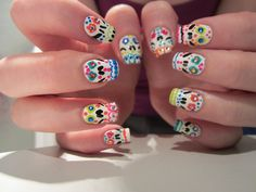 Sugar skulls. Far from perfect, but they remind me of Grim Fandango :)  More original nail art.