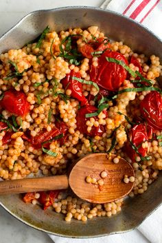 NYT Cooking: This is a simple dish with few ingredients and lots of flavor. The sauce, inspired by Melissa Clark's pasta with burst cherry tomatoes, is incredibly sweet and wraps itself around each nu Vegetarian Recipes, Cooking Recipes, Healthy Recipes, Healthy Snacks, Israeli Food, Couscous Recipes Israeli, Pearl Couscous Recipes, Israeli Couscous Salad, Gastronomia
