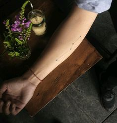 Small constellation tattoo on the arm