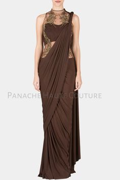 This Chocolate brown color designer saree gown is featured in crepe fabric with golden hanb embroidered blouse. The yoke style or color can also be customised