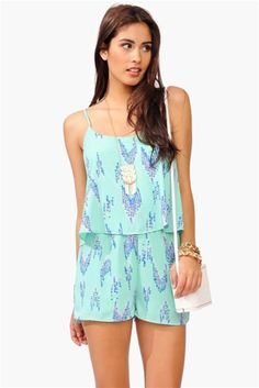 Here is a more up to date playsuit or romper as it is known today with a more flowy and casual fit that still includes spaghetti straps and a high waist with a different neckline called a boat neck. Today rompers are not just a style worn on warm summer days but can also be made very formal with different fabrics. patterns and designs. 3/20/16