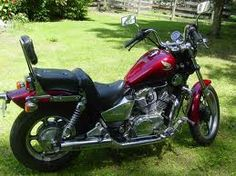 Honda Shadow 700. My current ride. A gift from first hubby when I caught him with someone he shouldn't have been with.  :)