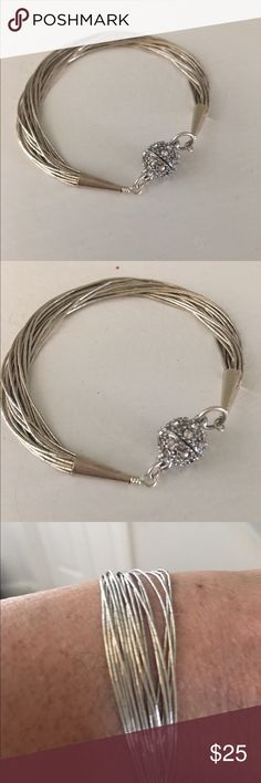 Liquid silver Bracelet Let me count the strands of this beautiful liquid silver. Dainty and delicate. 20 strands with strong magnetic clasp I added for easy on and off. Looks georgous with multiple other bracelets of SW design.  Thank you for looking. ❌FIRM on price unless bundled for 10% discount❌ Jewelry Bracelets