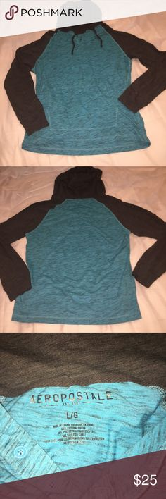 Hollister Two Tone Hooded Long Sleeve T-Shirt This Hollister hooded long sleeve shirt  is a nice shade of aquamarine and gray. It's a lightweight material, 60% cotton and 40% polyester. The hood is lined, which makes it perfect for blocking the wind. Hollister Shirts Sweatshirts & Hoodies