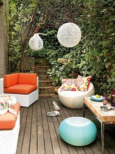 Lovely modern patio design for small space with white orange sofa and light blue pouffe also yellow floral throw pillow idea