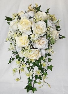 Lush and Rich Roses Ivory Cascading Bouquet- maybe with yellow breath and/or billy balls?