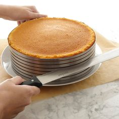 "This layer cake slicing kit includes: -(1) 12-inch bakers knife-(1) adjustable slicing mold-(1) 11-inch cake lifter, $60  Fits cakes up to 10-11 inches in diameter Slices up to eight even layers Measures: 14"" x 12"" x 5"" Material: High grade Stainless Steel Dishwasher safe 5-year warranty Made in Germany"