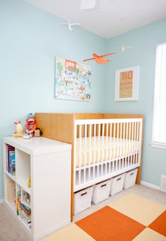decorating small spaces nursery with storage under crib