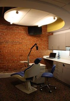 Othodontist Office Design: This orthodontist office design highlights the historic  features of an old saw mill, by contrasting them to new  architectural design elements.