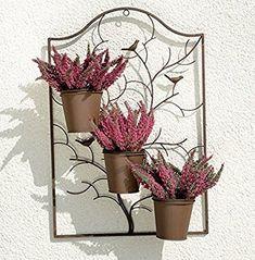 Risultati immagini per finestre con vasi da fiori