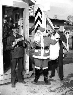 Santa Claus is detained at the Elza Gate in Oak Ridge in this famous 1944 photo taken by famed Manhattan Project photographer Ed Westcott.