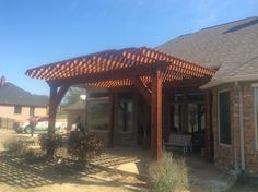 This is a cedar wood pergola GroundScape Solutions stalled in Saginaw Texas. If you would like to have your very own Pergola give us a call at Saginaw Texas, Wood Pergola, Cedar Wood, Landscaping Company, Texas Homes, Outdoor Structures, Arbors, Landscape, House