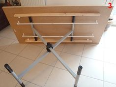 Coffee table by day. Simple hack using ironing board mechanism makes for a dining table by night. Clever!