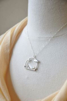 This cute necklace features a pendant with a tiny mother of pearl bird sitting on a branch suspended on a delicate shimmering sterling silver chain. An adorable necklace that is perfect for everyday wear.  Dimension  Pendant: 1 inch x 1 inch Total chain length: 17 inches + 2 inch extension  Thanks for looking.  Your order will be packaged in a white jewelry box, sealed with a YSM Designs logo and ribbon, ready to be given as a gift. Please let me know if you would like to include a gift…