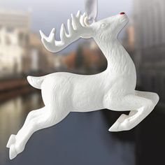 """The 2017 Figural Reindeer Ornament by Wedgwood is three dimensional and beautifully crafted of fine white porcelain with a red accented nose. Wedgwood Ornaments are inspired by traditional relief designs that date back to the late 18th century. Holiday scenes and figures, along with favorite Wedgwood icons, decorate these collectable ornaments. This delightful Wedgwood Figural Reindeer Ornament will surely be a wonderful addition to your holiday tree. The ornament measures 3.4"""" high and ..."""