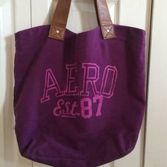 Aeropostale Faux Leather Handle Purple Tote Nice size purple tote from Aeropostale. I'm great condition, two small stains on the back, see photo. Cute polka dot pattern inside. Make me an offer today! Aeropostale Bags Totes