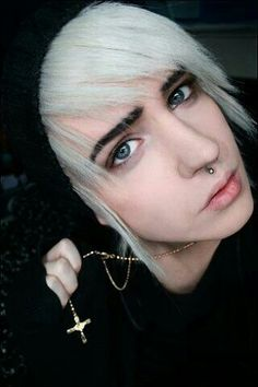 Blond hair, bull ring piercing, pretty blue eyes, and is totally hot!:)
