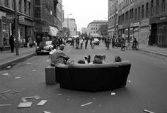 Oranienstrasse 1984, Berlin, Germany Street Festival in the famous Oranienstrasse. After the May Day Demonstrations the alternative economy plies its wares on the street, here punks have pulled their living room sofa onto the street and are enjoying a few beers