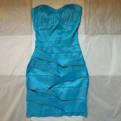 Night out mini dress Strapless mini dress , gorgeous sheen neon blue color. Never worn due to weight gain :( hot gal Dresses Strapless
