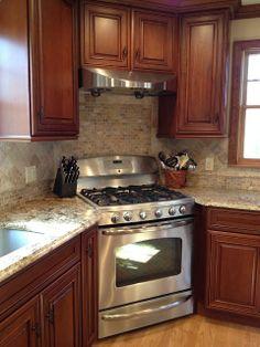 kitchen designed with a corner stove #kitchens #interiordesign Love the color…