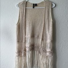 Boho Fringe Vest Tan Fringe boho Vest. In perfect condition, no pulls. Great for festival season. Size Large. Looks best on S/M oversized. #festival #vest #fringe #boho #tags #wishlist #iso #sale #cheap #aa #americanapparel #topshop #freepeople #urbanoutfitters Free People Jackets & Coats Vests