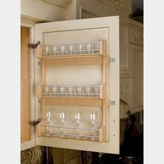 "$50.99 · Maintain shelf space and keep spices within reach with this Wood Classic Door Mount Spice Rack. Made of attractive maple hardwood, this storage saver features a UV-cured, clear finish that ensures an acceptable match to most cabinets, and easily installs with just four screws. Dimensions: 15.625"" Width x 3.125"" Depth x 21.5"" Height Minimum Cabinet Opening: 16"" Wide x 3.152"" Deep x 21.5"" High Shelf Inner Dimensions: 14.375"" Wide x 2.625"" Deep 8.625"" Height between shelves Adj.."