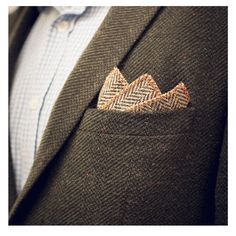 Our Harris Tweed Orange Hemmed Pocket Square is hand made in Britain and works well with a dark jacket to add that slight flourish of colour, sitting particularly well in a green or blue tweed jacket. We overlock our edges rather than hand roll them and limit the size to 20cm x 20cm due to the thickness of the fabric and to ensure the best finish. #pocketsquare #mensfashion #tweed #harristweed