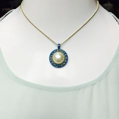 CHANEL Large Blue Mother of Pearl gold Pendant BEAUTIFUL! Authentic Stamped CHANEL Large Blue Mother of Pearl gold Pendant. This pendant will come to you in a black velvet Chanel drawstring jewelry pouch. This pendant measures 1.25 inches in diameter and does not come with the necklace pictured. RETAILS $250.00 CHANEL Jewelry
