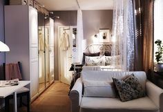In an open studio or loft, curtains can help create privacy and define spaces.