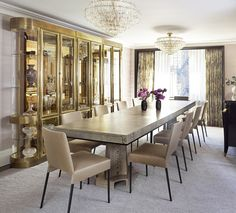 Dining Room decor ideas - extra long table with double crystal chandelier, gold accents. | wesley moon NYC apartment