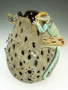 "Featured Gourd of the Month:""Snacktime""Carved gourd with added cholla wood, Collared Lizard made from Apoxie Sculpt, and brass butterflies.By Bonnie Gibson"