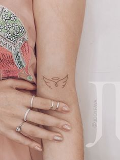 Angle Wing Tattoos, Wing Tattoos On Wrist, Angle Tattoo, Tiny Tattoos For Girls, Tattoos For Women Small, Tattoos For Guys, Tattoos For Couples, One Word Tattoos, Subtle Tattoos