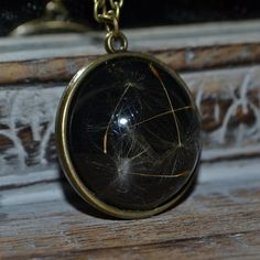 Items similar to Midnight Wishes: Real Dandelion Seed Resin Spherical pendant on a bronze setting - Childhood Memories on Etsy Resin Jewellery, Botanical Flowers, Childhood Memories, Pocket Watch, Dandelion, Bronze, Trending Outfits, Pendant, Unique Jewelry
