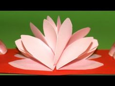 This is a pop-up lotus flower card. It's kirigami- the Japanese art of paper-folding and paper-cutting. The demonstration is in Spanish, but the demonstration is easy to follow visually, and is quite simple. Besides, you can re-run as often as you need. Tarjeta Pop-Up Flor de Loto - DIY - Lotus Flower Pop-Up Card