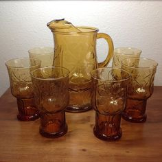 Vintage Libbey Amber Country Garden pitcher with six tall glasses. Pressed amber glass with daisy motif. Pitcher holds about 2qts. and