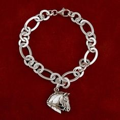 """Dressage sterling silver horse head on sterling silver oval link bracelet with lobster closure measures 7 1/4"""". Horse head measures 7/8"""" x 7/8"""". Can come with other horse heads as well."""