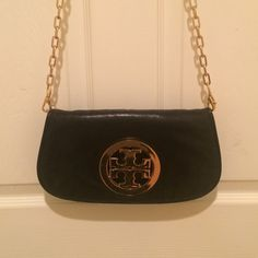 Black Tory Burch Purse Tory Burch cutch with removable gold chain strap. Can be worn as cutch, cross-body, or shoulder strap! Tory Burch logo is solid gold. Tory Burch Bags