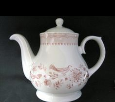 The Penrose Hill earthenware teapot is a balance between a sturdy tea pot and a delicate color scheme. A rosy pink Pennsylvania Dutch style motif surrounds the pot with a matching adorned border encircling the top. Made in England.  Matching Penrose Hill teacups and saucers are available.  38 oz capacity  Earthenware Made in England. Safe for Dishwasher & Microwave.