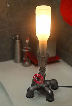Hey, I found this really awesome Etsy listing at https://www.etsy.com/listing/78577037/bedside-lamp-beer-bottle-plumbing-pipe