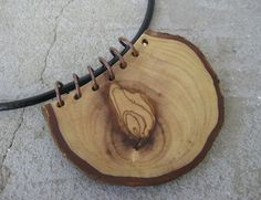 Handmade necklace made of patinated copper wire and olive wood with black leather cord. Made from Mediterranean olive wood - raw natural structure preserved. Because of its durability and resilience, Olive wood is a symbol of strength. Size of the pendant: height about 6 cm, width: about 8,5 cm, thickness about 0,7 cm Necklace is about 26 cm long. ? Back to my shop : www.etsy.com/shop/Stelakastel... * Be sure to check out this helpful article.