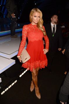 That's hot! Paris Hilton looked red hot in a lace dress at the People's Choice Awards on Jan. 8, 2014. The blond bombshell lapped up the attention while posing for the cameras at the star-studded event.