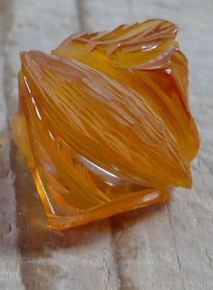Apricot Prystal Carved Bakelite Ring from LooLuu's on Ruby Lane!